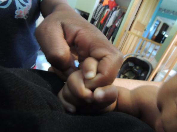 Mazie holding Josiah's hand