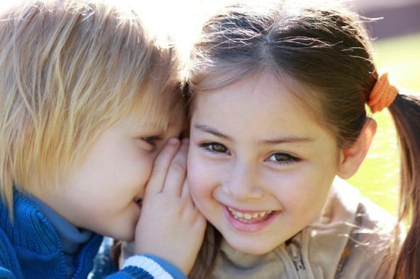 boy-whispering-to-girl[1]